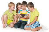 Kids plaing with a gadget — Stockfoto