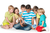 Children playing with a gadget — Stock Photo