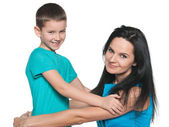 Smiling young boy with his mother — Stock Photo