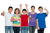 Happy children hold their thumbs up — Stock Photo