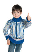 Young boy in a sweater holds his thumb up — Stock Photo