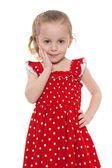 Amazed little girl in a red dress — Zdjęcie stockowe