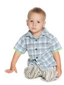 Serious little boy against the white — Stock Photo