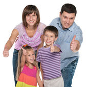 Family holding their thumbs up — Stock Photo