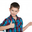 Young boy shows his finger aside — Stock Photo #43727707