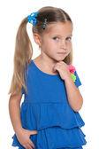 Pensive little girl against the white — Stock Photo
