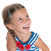 Laughing little girl looks aside — Stock Photo
