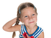 Dreaming cheerful little girl  — Stockfoto