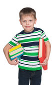 Smiling little boy with books — Stock fotografie