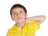 Thoughtful little boy looks up — Stock Photo