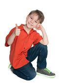 Uśmiechnięty chłopiec moda z jego kciuk — Zdjęcie stockowe