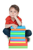 Thoughtful little boy with books — Stock Photo