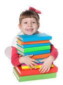 Clever little girl near books — Stockfoto