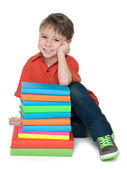 Smiling little boy with books — Foto Stock