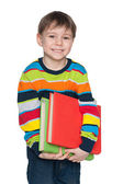 Cute smiling little boy with books — Foto Stock