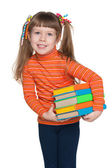 Clever little girl with books — Foto Stock