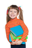 Happy clever little girl with books — Stock Photo