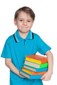 Cute little boy with books — Stock Photo