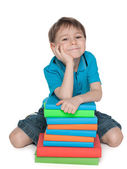 Cute young boy with books — Foto Stock