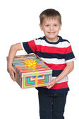 Cute little boy holds a gift box — Stok fotoğraf