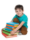 Smiling little boy with books — Stock Photo