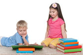 Two children with books on the floor — Stock Photo