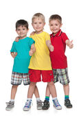 Three cheerful boys hold his thumbs up — Stock Photo
