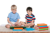 Two boys with books on the floor — Stock Photo