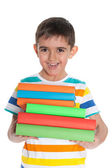 Laughing young boy with books — Стоковое фото