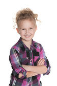 Laughing little girl on the white background — Stockfoto