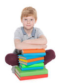 Clever young boy with books — Stock Photo