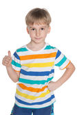 Little boy holds his thumb up — Stock Photo