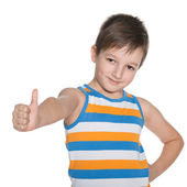 Young boy in the striped shirt holds his thumb up — Stock Photo