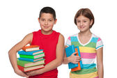 Preteen boy and girl with books — Stock Photo