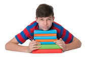 Pensive teenager boy with books — Stock Photo