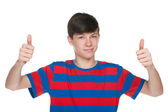 Teen boy holds his thumbs up — Stock Photo