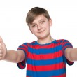 Teenager boy holds his thumbs up — Stockfoto