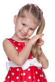 Shy little girl in a red polka dot dress — Stock Photo
