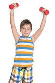 Young boy with dumbbells — Zdjęcie stockowe