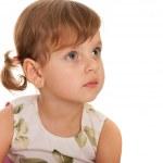 allvarliga liten flicka tittar bort — Stockfoto #8982680