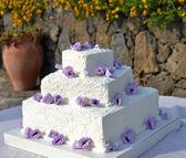 Wedding cake with roses — Stock Photo