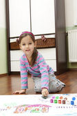 Little girl bedaubed with bright colors — Stock Photo