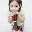 Little musician with guitar — Stock Photo