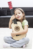 Smile girl with guitar — Stock Photo