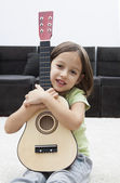 Little artist with guitar — Stock Photo