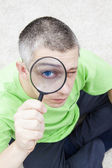 Man with magnify glass — Stock Photo