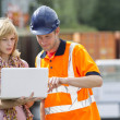Stock Photo: Businesswoman and worker with laptop