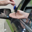 Man Receiving Car Key. - Stock Photo