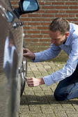 Man Using Duct Tape To Fix Car. — Stock Photo