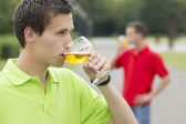 Young student drinking something — Stock Photo